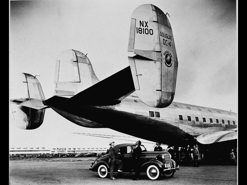 Douglas DC-4 with automobile under the tail of the airplane, 1938